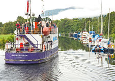 Jacobite Queen Loch Ness bound. An image of the Jacobite Queen carrying tourists and leaving Dochgarroch lock for a cruise on Loch Ness Stock Photo