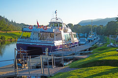 Jacobite Rebel. New boat, Jacobite Rebel, at Dochgarroch on the Caledonian Canal which takes tourists on Loch Ness looking for the monster Royalty Free Stock Images