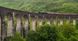 The Jacobite, steam train, Crossing Glenfinnan Viaduct. The Jacobite on its way to Mallaig on west coast of Scotland Royalty Free Stock Photo