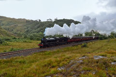 The Jacobite steam travells through Scottish Highland Stock Photos