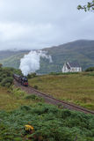 The Jacobite steam travells through Scottish Highland Royalty Free Stock Photo