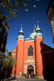 Jacobs Red Church Stockholm. Jacobs Red Church in Stockholm during spring with cherry flowers and fantastic blue sky Royalty Free Stock Image