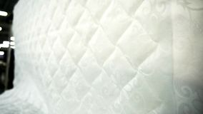 Jacquard fabric for upholstery mattresses in furniture factory indoors. stock footage