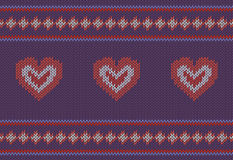 Jacquard pattern with red hearts on purple background. Stock Photos