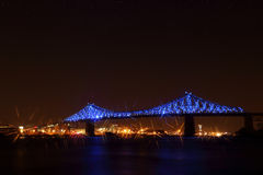Jacques Cartier Bridge Illumination in Montreal, reflection in water. Montreal's 375th anniversary. Stock Photos