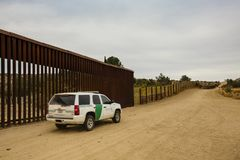 Border Patrol Driving Near Wall royalty free stock photography