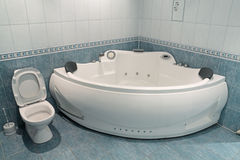 Jacuzzi. Interior of a bathroom with a toilet bowl and a jacuzzi royalty free stock photography