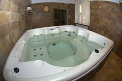 Jacuzzi. In wooden bathroom with water stock photos