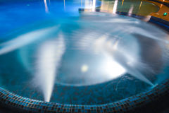 Jacuzzi in blue swimming pool Royalty Free Stock Images