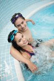 Jacuzzi couple. Vertical shot of young people relaxing in jacuzzi Royalty Free Stock Photos