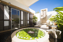 Jacuzzi decoration by flowers and foliage in spa room Stock Photos