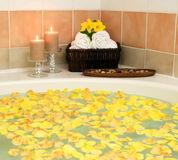 Jacuzzi hot tub spa bath flowers candles. Jacuzzi with yellow rose petals Stock Images
