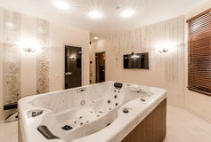 Jacuzzi. Interior of modern bathroom with jacuzzi royalty free stock photos