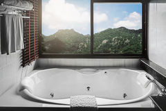 Jacuzzi with mountain view Stock Photos