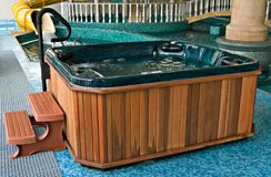 Jacuzzi near the swimming pool Royalty Free Stock Photos