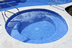 Jacuzzi outdoor blue swimming pool Stock Photos