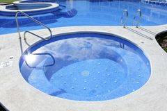 Jacuzzi outdoor blue swimming pool Royalty Free Stock Photography