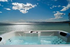 Jacuzzi. Spa against a view of mediterranean sea Stock Image