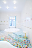 Jacuzzi and stairs in spacious white bathroom Stock Images