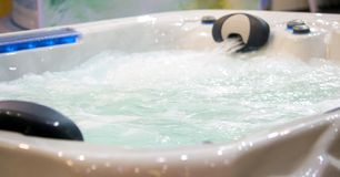Jacuzzi waterfall bath with water. Water jet close-up royalty free stock photos