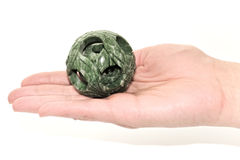 Jade ball. A hand of a woman with jade ball symbolizing good luck isolated on white background Stock Image