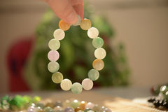 Jade beads bracelet shining under the light Stock Photos