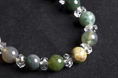 Jade bracelet. With diamonds on black Stock Photos