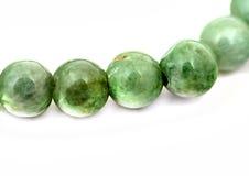 Jade bracelet fragment isolated on white Royalty Free Stock Photography