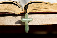 Jade Cross. The Holy Bible and the cross royalty free stock image