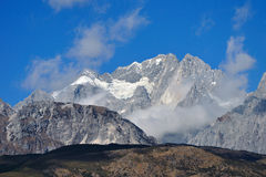 Jade dragon snow mountain. Sunny weather of jade dragon snow mountain royalty free stock photo