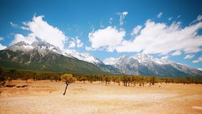 Yulong Snowmountain. Jade Dragon Snow Mountain is a snow mountain group in Lijiang, Yunnan, China. It is about 15 kilometers north of Lijiang, with a total royalty free stock photography