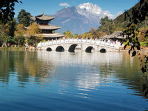 Jade dragon snow mountain, Lijiang. With black dragon lake royalty free stock images