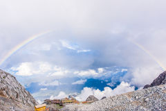 Jade dragon snow mountain. Look down from the hilltop of Jade dragon snow mountain , beautiful Rainbow in the sky, lijiang ancitent town royalty free stock images