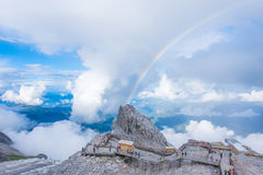 Jade dragon snow mountain. Look down from the hilltop of Jade dragon snow mountain , beautiful Rainbow in the sky,lijiang ancitent town royalty free stock photography