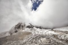 Jade Dragon Snow Mountain peak covered with clouds, China Royalty Free Stock Photography