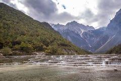 Jade Dragon Snow Mountain. Terraces in Lijiang, Yunnan province, China Royalty Free Stock Photo