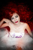 Jade eyes, beautiful red hair lady. Over dark background stock photography