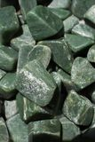 Jade gem stone as natural mineral rock. Specimen Stock Photo