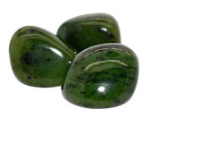 Jade gemstone. Set of a beautiful tumbled Jade semiprecious stones isolated on white stock photos