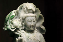 Jade goddess. Guanyin in dark background Royalty Free Stock Images