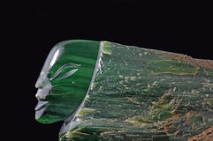Jade head. Jade carving of human head in natural greenstone, West Coast, South Island, New Zealand Stock Photography