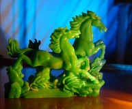 Jade Horses. A jade statue of two horses running Stock Photos