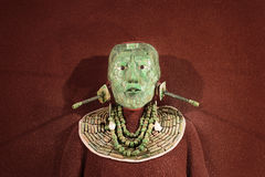 Jade mosaic funeral mask and the jewelry found in the tomb of Mayan king Pakal from Palenque, the National Museum of Anthropology. Jade mosaic funeral mask and stock photos