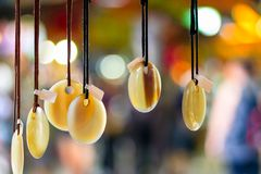 Jade necklaces hanging on display at Camden Market Stock Photos
