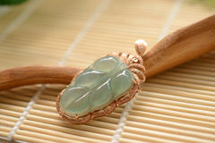 Jade pendant framed by gold Stock Images