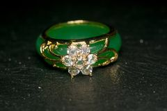 Jade ring with diamonds royalty free stock photography