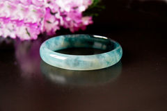 Jade ring and flower Stock Photography