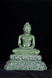 Jade sculpture of buddha isolated on black background Stock Image
