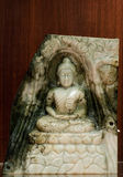 Jade sculpture of buddha  on wooden background Stock Photo