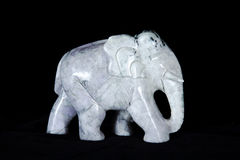 Jade sculpture of elephant isolated on black background Stock Images